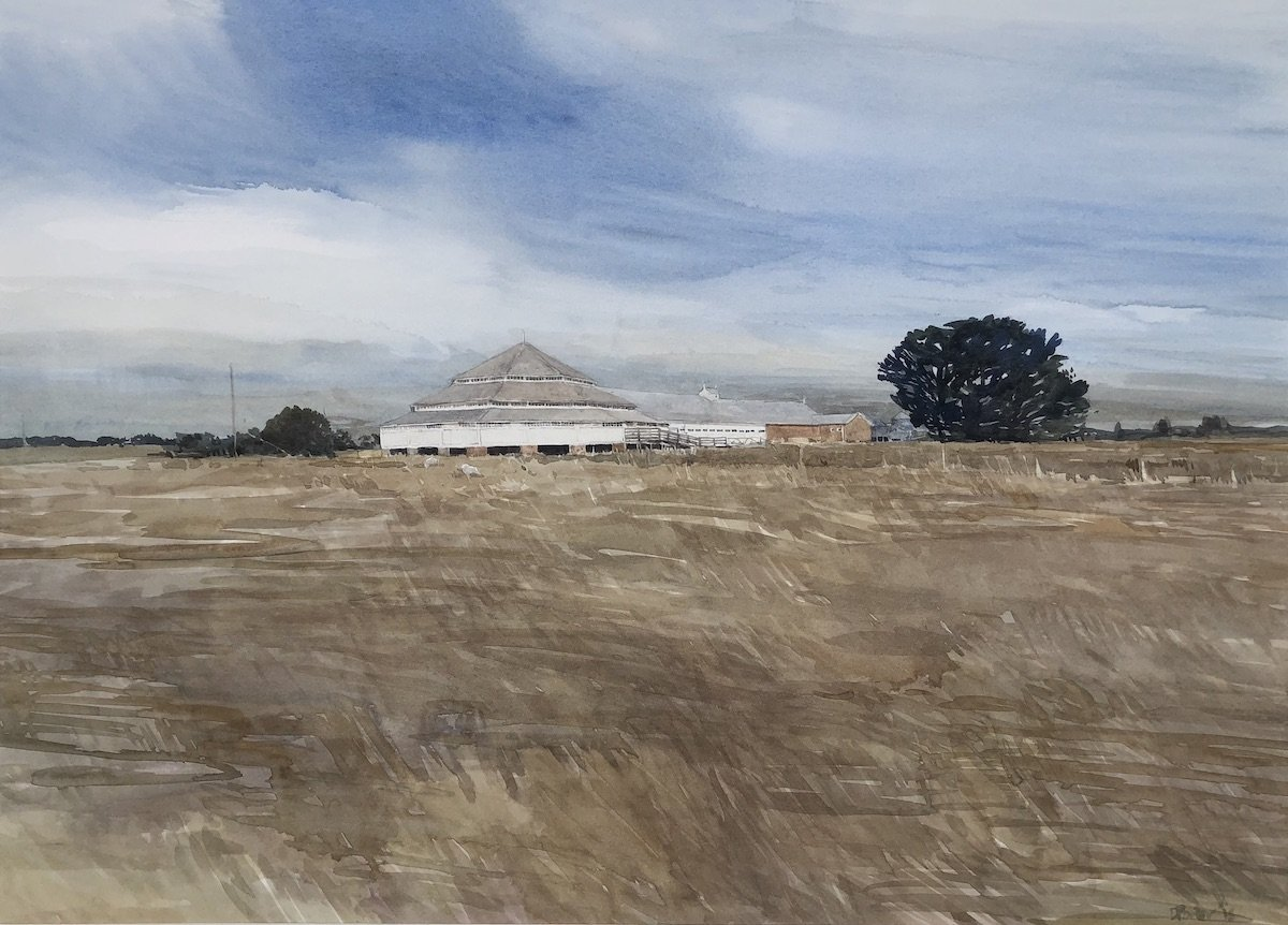 "Watercolour painting by Christine Porter of the shearing shed at ""Deeargee"", near Uralla: a large octagonally shaped woolroom with other parts of the building showing in the distance."