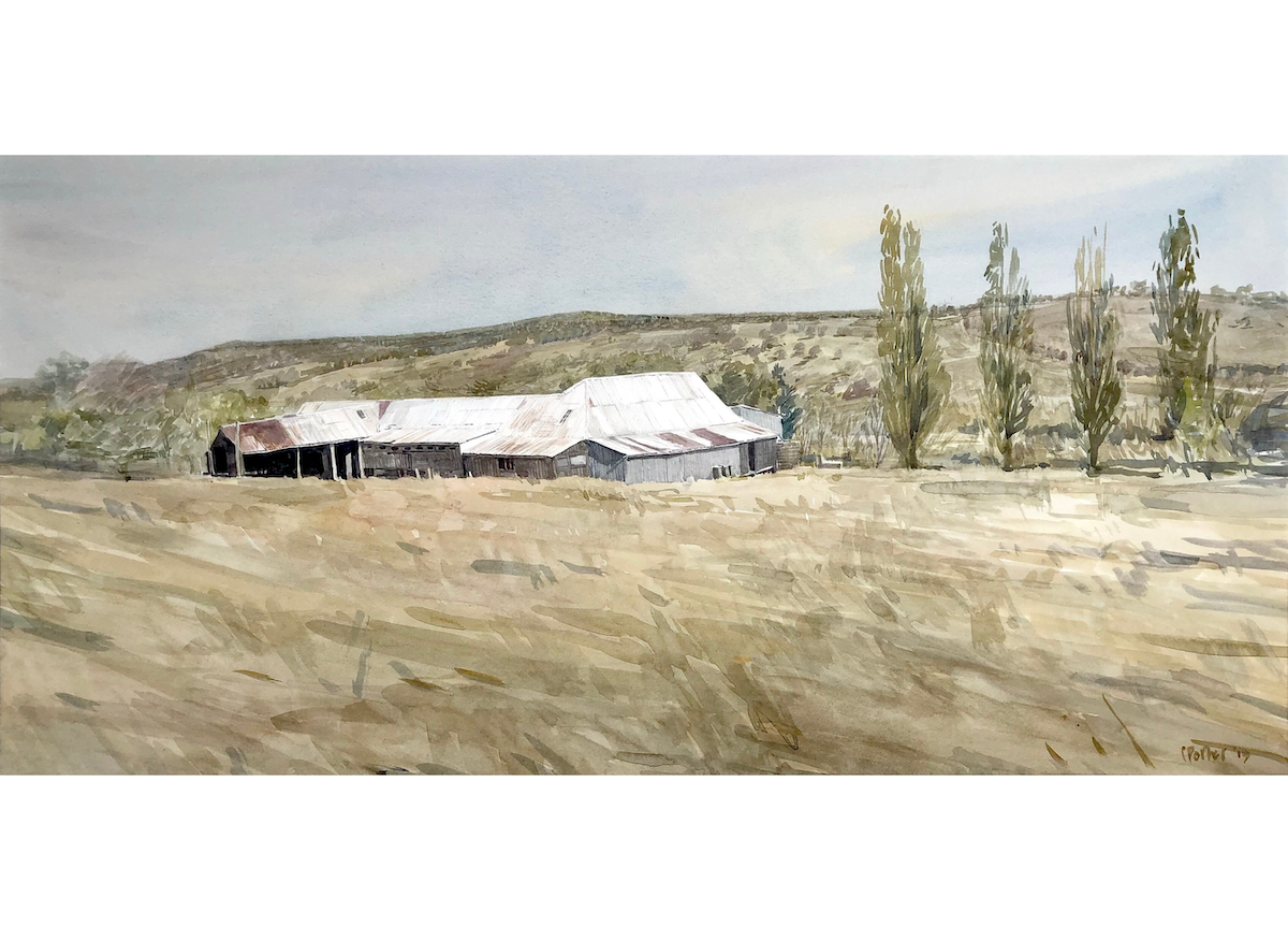 "Watercolour painting by Christine Porter of the shearing shed at ""Boorolong"" near Armidale , looking down on the old shed corrugated iron room. and in the distance landcsape of hills and trees showing in the distance."