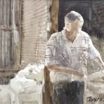 Watercolour painting by Christine Porter showing a man ij a shite and brown shirt skirting a fleece at a wooltable.