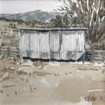 Watercolour painting by Christine Porter showing a small corrugated iron shed inside someyards. In the distance is a mountain range.