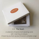 A photo of a box with the lid partly off. It shows one of Christine's cards inside and an orange sticker on the top with her logo. Printed over the photo are the details of this product